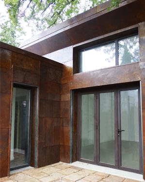 ossature bois facade acier corten